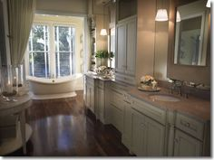 We copied this bathroom idea. Used Home Depot Black Distressed Cabinets and Carrera Marble & Restoration Hardware's Palais Tub. Master Bathroom of the 2009 HGTV Dream Home