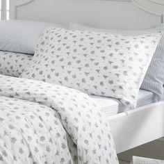 little blue flowers adorn this bed linen