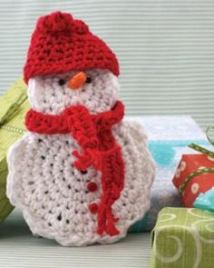 Crochet Patterns Free Pattern - The Snow Man Gift Card Cozy lets simple gifts shine! - These 10 free crochet snowman patterns let you bring the joy indoors - and you can still have hot chocolate when you're done making them! Crochet Christmas Decorations, Christmas Crochet Patterns, Holiday Crochet, Crochet Gifts, Free Crochet, Free Knitting, Knitting Patterns, Tree Decorations, Crochet Snowman