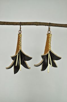 Black Tiger Lily Genuine Leather Earrings. $35.00, via Etsy.