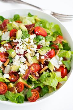 BLT Avocado Chopped Salad with Lemon Vinaigrette - Bacon, grape tomatoes, avocados, almonds, feta, romaine and fresh lemon vinaigrette. So good!