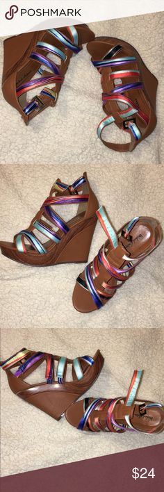 👠👠👠 MULTI COLOR EDGY WEDGE HEELS 👠 👠 COGNAC/MULTI COLOR WEDGE HEELS. Pre Loved still in great condition. Edge of heels in back shows some wear as shown is pics 👀 still has ton of life to them. Size 8 1/2...............COLORS MAY APPEAR LIGHTER/DARKER DUE TO MONITOR PIXEL VARIATIONS!!!    MEASUREMENTS ARE APPROX.. SELLER CANNOT GUARANTEE FIT... Michael Antonio Shoes Wedges
