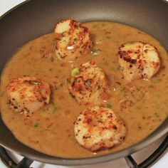 Scallops in butter & white wine sauce. I added garlic to the recipe and used sparkling rose.