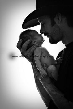 What is it about a cowboy holding a baby?? Lol SO hot.