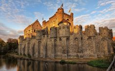https://wallpaperscraft.com/image/belgium_castle_moat_wall_58811_3840x2400.jpg