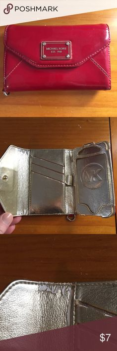 Michael Kors phone and card case Michael Kors phone and card case. Used but good condition. Please see imperfections in pic. Held an iPhone 4s. Can still be used as a card carrier and has a metal attachment for keys. Michael Kors Bags Wallets