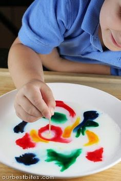 Place milk in shallow dish- add drops of food coloring. Now grab a *magic* toothpick.  What? You don't know where to buy magic toothpicks?? Just dip the end in dish soap & touch the milk with it. Colors instantly shoot out at lightning speed creating a wake of rainbows!  Try dipping the toothpick in the color first and then the milk and you'll make rings.