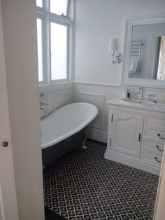 Think I'm gonna have to get black and white floor tiles in my bathroom. These ones by Jatana Interiors