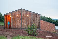 Low-cost Eucalyptus screen shields a hospital dormitory from Rwanda's scorching sun!