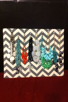 Chevron Jewelry Holder - but use old wallpaper