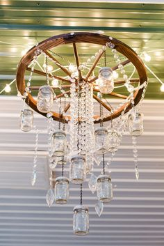 Hanging Mason Jar and Crystal Chandelier | Private Residence – Live Oak, Florida | Ailyn La Torre Photography https://www.theknot.com/marketplace/ailyn-la-torre-photography-tampa-fl-563564