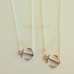 silver and gold little anchor necklaces