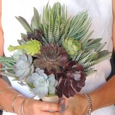 """Once you see a bouquet of succulents it's easy to say """"""""I do"""""""". Whether it's all succulents or succulents with mixed flowers it'll be a bouquet to remember."""