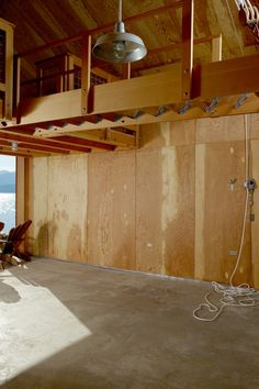 Image 11 of 15 from gallery of Hood Canal Boat House / Hoedemaker Pfeiffer. Photograph by Alex Hayden Retractable Ladder, House Ladder, Loft Staircase, Attic Stairs, Barn Loft, Journal Du Design, Boat Storage, Canal Boat, Loft Design