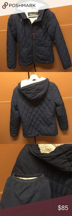 Eddie Bauer women's down parka Navy blue, lines down parka. Worn but gently used, and well taken care of so no signs of wear yet! Detachable fur that can be buttoned on to the hood for added coziness. Sits right below hip bones on the previous owner who is 5'2. Water resistant Eddie Bauer Jackets & Coats
