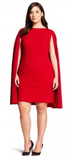 c66b8c70c4ba This eye-catching cape dress mixes a flowing cape back with a classic  bateau-neck sheath