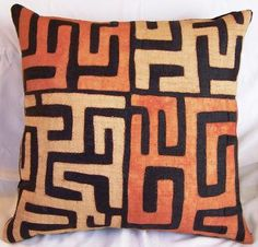 "Kuba Cloth Pillow - Fair traded Kuba cloth from the Congo fashioned into a 18"" x 18"" decorator pillow.  Insert is hypoallergenic; backing is black linen/rayon blend; pillow is finished with an invisible zipper.  This pillow was constructed by Maggie Crago in the USA."