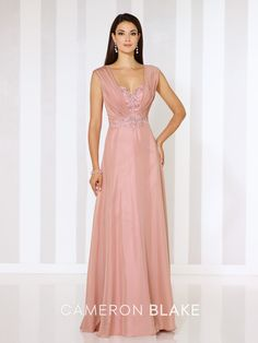 Chiffon A-line gown with slight cap sleeves, hand-beaded sweetheart bodice trimmed with ruched chiffon, beaded motif at natural waist, keyhole back, flyaway skirt with sweep train. Matching shawl included. Sizes:4 – 20 Colors:Rose Quartz, Light Taupe, Wedgwood
