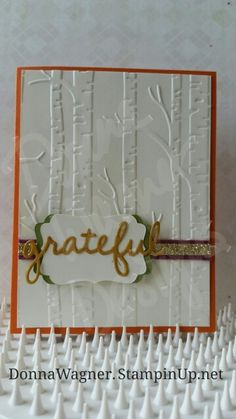 """Card made using Tangelo Twist, Old Olive, Delightful Dijon and Very Vanilla Cardstocks, Gold Glimmer Paper, the Decorative Label Punch, the Seasonal Frame Thinlits Dies, the Woodlands Textured Impressions Embossing Folder, the Into The Woods 3/8"""" Cotton Ribbon, Fast Fuse and Crystal Effects adhesives, and Dimensionals. #stampinup Stampin' Up!"""