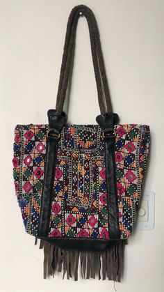 Beautiful boho banjara embroidered handcrafted bag perfect for office or shopping day out!Accessorise it up with a white shirt and blue jeans. Hippie Bags, Boho Bags, Customised Denim Jacket, Festival Coats, White Shirt And Blue Jeans, Vintage Patches, Embroidered Bag, Shopping Day, Vintage Textiles
