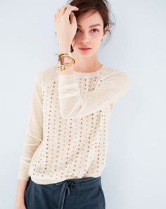 Cute sweater. J.Crew women's stacked sequin sweater, wood and pavé cuff, thick cylinder cuff and open hexagon cuff bracelets.