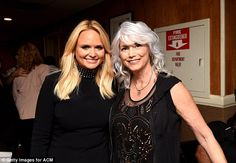 All smiles: Miranda and Emmylou flashed their pearly whites backstage ...