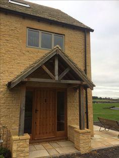 Black aluminium seamless guttering on a farmhouse in Gloucestershire