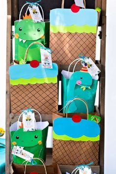 Check out this fun dinosaur birthday party! The party favor bags are a blast! See more party ideas and share yours at CatchMyParty.com #catchmyparty #partyideas #dinosaurs #dinosaurparty #boybirthdayparty #partyfavor Dinosaur Party Favors, Boy Party Favors, Dinosaur Birthday Party, Party Favor Bags, Baby Shower Favors, Girl Birthday, Birthday Parties, Ice Cream Party, Packaging Ideas