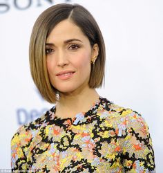 Gorgeous: Her glossy bob was blow dried straight, with luscious caramel tips and chocolate...
