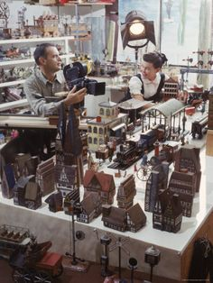 Designers Charles Eames and Wife Ray Eames Filming Toy Trains at Their Studio