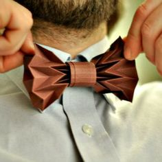 Make this folded paper bow tie to decorate a Father's Day gift. (via Justina Yang of Fiber Lab)