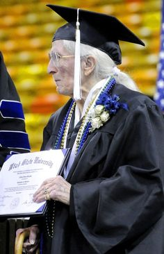 Twila Boston, 98, holds her diploma after graduating from Utah State University in May 2012. She is the oldest known graduate from USU. (Photo by Eli Lucero)