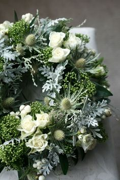 A beautiful white, silver grey but predominately green wreath. Perfect for a wed… A beautiful white, silver grey but predominately green wreath. Perfect for a wedding or event where the colour blend is the simplicity of white and green. Arrangements Funéraires, Funeral Arrangements, Christmas Arrangements, Christmas Door Wreaths, Christmas Flowers, Christmas Decorations, Flower Wreath Funeral, Funeral Flowers, Deco Floral