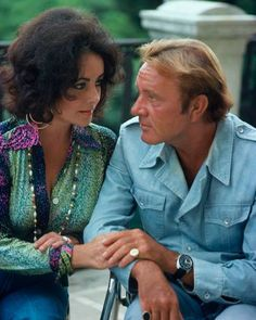 Elizabeth Taylor gazes at Richard Burton as he gazes at his impossible mate. What an unbelievable couple. So much bigger than life and so much smaller than the possibilities.