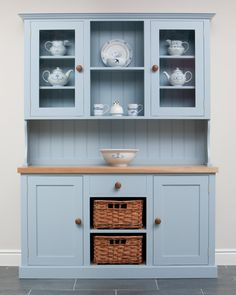 The Malthouse dresser provides a good mix of storage space behind cupboards, within a drawer and inside the two baskets, as well as some open shelving. The baskets are made from Almond Willow and hand woven in Yorkshire.