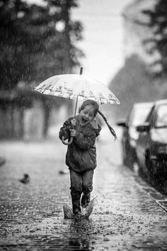 Rain Photography with kids. so me except I would have dropped the umbrella LOVE the rain! Walking In The Rain, Singing In The Rain, I Love Rain, Rain Photography, Parasols, Getting Wet, Rain Drops, Rainy Days, Black And White Photography