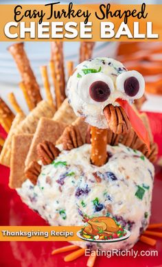 This turkey shaped cheese ball is ridiculously cute, and surprisingly easy to make. You can even add veggies like carrot sticks and sliced bell peppers to the tail! #thanksgiving #thanksgivingdinner #christmas #christmasdinner #holiday #holidaydinner #appetizers #appetizer #appetizerrecipes #thanksgivingappetizers #cuteappetizers #recipes #cheeses #cheeseball #cutefood #cheese #pretzels #crackers #dairy #cranberries #pecans