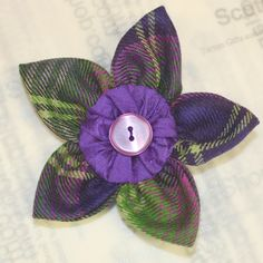 Flower brooch in the Scottish tartan of your choice pictured here in Troon tartan