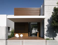 Facade - eHouse is a single family house that was inhabited in 2008 and borrows from two traditions in architecture - a Mediterranean aesthetic of sun and light and a minimalist discipline of line and plane.