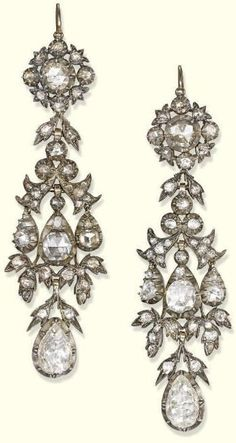 A PAIR OF ANTIQUE DIAMOND EAR PENDANTS. Each designed as a detachable articulated foliate rose-cut diamond pendant to the rose-cut diamond floral cluster surmount, with closed-back setting, mounted in silver and gold, 19th century. #Georgian #antique #earrings