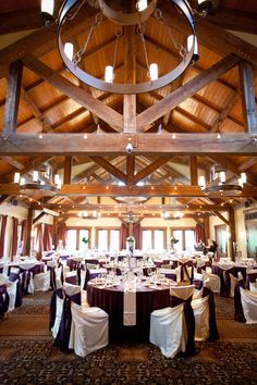 A Rustic Rocky Mountain Wedding in Purple Rocky Mountains, Summer Wedding, Chandelier, Ceiling Lights, Rustic, Weddings, Table Decorations, Purple, Home Decor