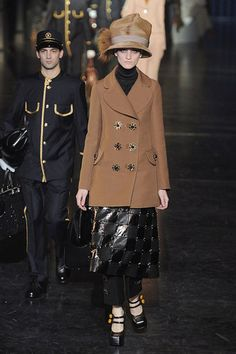 Louis Vuitton is trying to make big hats and peacoats a trend everybody!