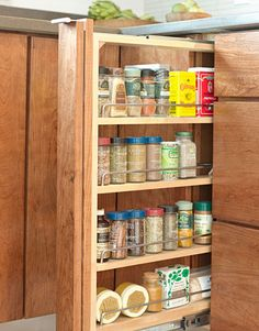 Consider a Spice-Rack Cabinet- If you're renovating your kitchen, a slim spice rack takes advantage of unused space and neatly solves the problem of organizing spices. Annie Selke had this one built into the ranch-house kitchen she updated.