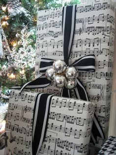 Can't get enough of that sheet music gift wrap!!! Bebe'!!! Love this too!!! If you can't find sheet music wrapping paper take favorite sheet music of holiday songs to Stapes and have them make poster size copies!!! Instant Christmas sheet music wrapping paper!!!