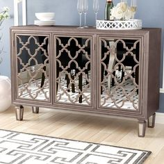 Store your extra dinnerware, flatware, and table linens in a buffet table or sideboard. Shop our great selection of stylish buffet tables and sideboards. Mirrored Sideboard, Mirrored Furniture, Deco Furniture, Credenza, Cool Furniture, Mirror Buffet, Sideboard Buffet, Entryway Decor, Bedroom Decor