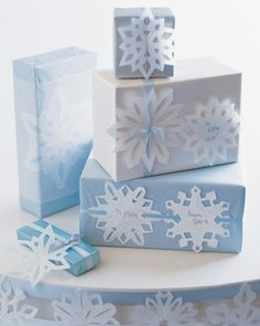Paper snowflakes aren't quite as delicate as the real things are, but they make a fine filigree with which to adorn your holiday gifts, nonetheless. Thread ribbons through gaps in the snowflakes and tie around presents; glue flakes to plain wrapping paper, then cover with translucent tissue; or tie one on as a card.    Get the Snowflake Template