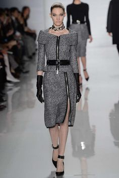 Michael Kors, SO cool, would not wear it, but such fun and interesting design on business textile.
