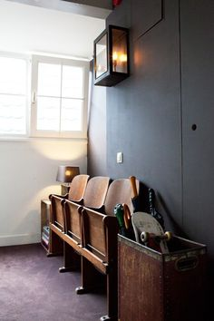 Love these vintage theater seats for an entryway