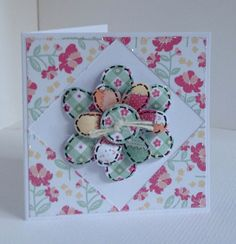 Card designed by Julie Hickey using Country Charm 6x6 paper pad, die cuts and template. Pretty patchwork card with flower in centre made using template onto a tiny card blank.