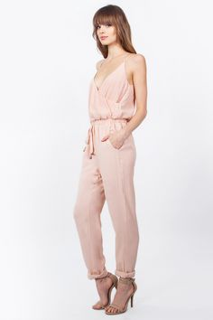 dec7752359c Cute and versatile peach jumpsuit. Dress it up with nude heels and dress it  down